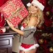Sensual blonde girl in Santa Claus costume — Stock Photo #59007249