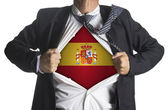 Flag of Spain with coat of arms and businessman showing — Stock Photo