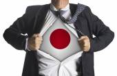 Japan Flag with businessman showing a superhero suit underneath — Stockfoto