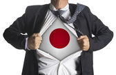 Japan Flag with businessman showing a superhero suit underneath — Stock Photo