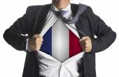 Businessman showing a superhero suit underneath country france f — Stok fotoğraf