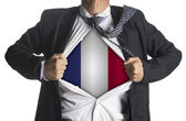 Businessman showing a superhero suit underneath country france f — ストック写真