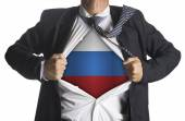 Russia Flag with businessman showing a superhero suit underneath — ストック写真