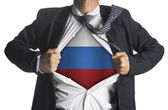 Russia Flag with businessman showing a superhero suit underneath — Stok fotoğraf