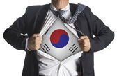 South Korea Flag with businessman showing a superhero suit under — Stockfoto