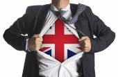 United Kingdom Flag with businessman showing a superhero suit un — Stock Photo