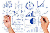 Hand drawing a chart writing business idea concept — Stock Photo