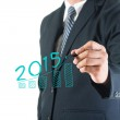 Businessman hand drawing growing graph 2015 new year — Stock Photo #58756439