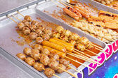 Delicious meatballs on skewers — Stock Photo