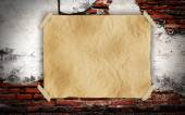Brown paper on brick wall — Stock Photo
