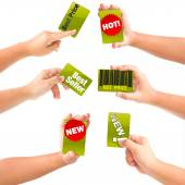 Hands with advertising cards — Stock Photo