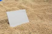 Blank cardboard on rice texture — Stock Photo