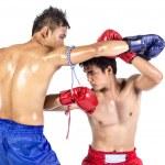 Two thai boxers exercising traditional martial art — Stock Photo #72015571