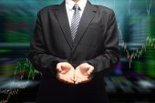 Business Man hand holding with stock market graph background — Stock Photo
