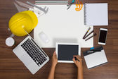 Office desk background hand written touchscreen on tablet — Stock Photo
