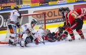Lulea, Sweden - March 18, 2015. Karl Fabricius  (52 Lulea Hockey) slides with full speed into opponents goalie. Swedish Hockey League-game, between Lulea Hockey and Frolunda Indians. — Stock Photo