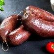 Uncooked fresh blood sausage with parsley and tomato. raw pork ready to cook — Stock Photo #68719099