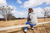 Teen Girl Sitting Outdoors Field — Stock Photo