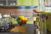 Kitchen furniture stone worktop with colored sweet peppers in gl — Stock Photo