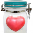 Heart shape red in a sealed jar — Stock Photo #64894831