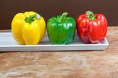 Bell pepper fresh green, red and yellow — Stock Photo