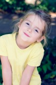 Little girl smiling at camera outdoor. — Stock Photo