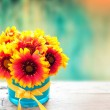 Fresh flowers in vase on wooden table. Vintage background. — Stock Photo #58163333