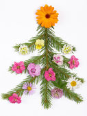 Christmas tree decorated with flowers — Stock Photo