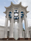 Colonnade and high fountain  — Stock Photo
