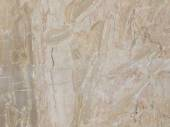 Slab of striped beige marble — Stock Photo