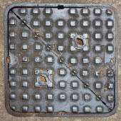 Square metal manhole cover — Photo