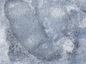 Brittle gray spring ice — Stock Photo