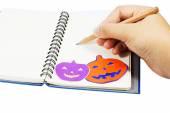 Holloween wording on notebook — Stok fotoğraf