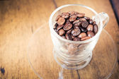 Roasted coffe bean on wood table — Stock Photo