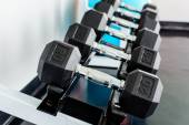 Rows of dumbbells on a rack in a gym — Stock Photo