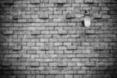 Old brick wall with lamp — Stock Photo
