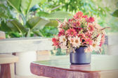 Flowers bouquet on woo table — Stock Photo
