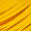 Gold crumpled silk fabric textured — Stock Photo #62976615