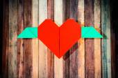 Red heart with wings and shadow — Stock Photo