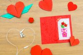 Red heart shape paper on wooden table — Stock Photo