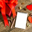 Blank notepad with red gift box — Stock Photo #64564401