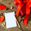 Blank notepad with red gift box — Stock Photo #64652325