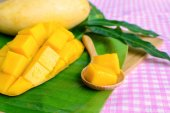 Yellow mango on wooden table — Stock Photo