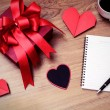 Blank notepad with copy space and red gift box — Stock Photo #66398719