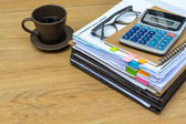 Stack of folders and documents with coffee — Stock Photo