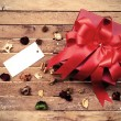 Red gift box with blank tag — Stock Photo #66888479