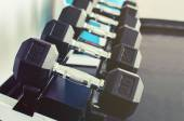 Rows of dumbbells on a rack — Stock Photo