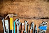 Set of work tools on old grunge wood background — Stock Photo