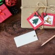Vintage gift box with blank tag on old wooden background, Christ — Stock Photo #78854282