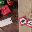 Vintage gift box with blank tag on old wooden background, Christ — Stock Photo #78854328